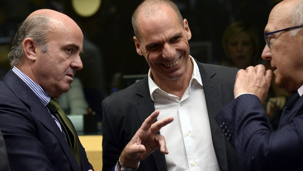 Greece's Finance Minister Yanis Varoufakis (C) speaks with his Spanish counterpart Luis De Guindos (L) and French counterpart Michel Sapinon prior to a Eurogroup meeting held at the Lex building in Brussels, on June 25, 2015. Greek Prime Minister Alexis Tsipras and his country's creditors failed to reach a bailout deal at emergency talks, raising fresh fears that Athens will default on an IMF loan next week.  The differences remain so great despite two days of marathon negotiations that the EU-IMF lenders and Greece will present rival reform proposals to eurozone finance ministers later in Brussels, sources told AFP.  AFP PHOTO/Thierry CharlierTHIERRY CHARLIER/AFP/Getty Images