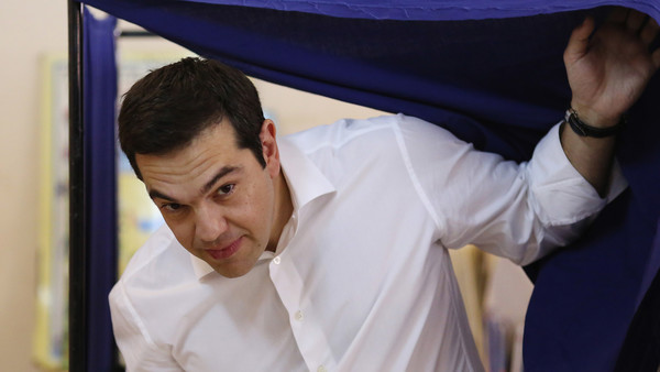 Alexis Tsipras, Greece's prime minister, exits a polling booth after filling in his voting card in the national referendum in Athens, Greece, on Sunday, July 5, 2015. Greeks are heading to the polls Sunday, evenly split on a referendum to chart a new course in their five-year economic crisis. Photographer: Chris Ratcliffe/Bloomberg *** Local Caption *** Alexis Tsipras