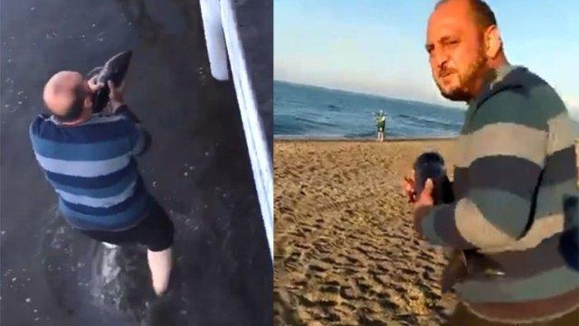 Gölde bulduğu yavru yunus balığını 200 metre koşarak denize bıraktı
