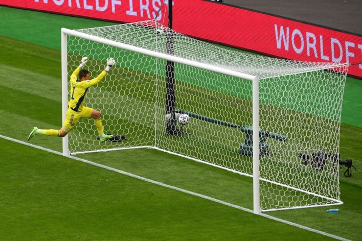 Scotland goalkeeper David Marshall makes a vain attempt to save the Czech Republic's Patrik Schick's (not in pic) goal-bound long range shot after being caught off his line.