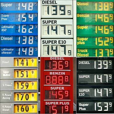 A combination picture shows price boards at various petrol stations in Dortmund, February 24, 2011.