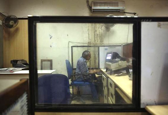 S R Gaur, 55, works inside the Central Telegraph Office in New Delhi July 10, 2013.