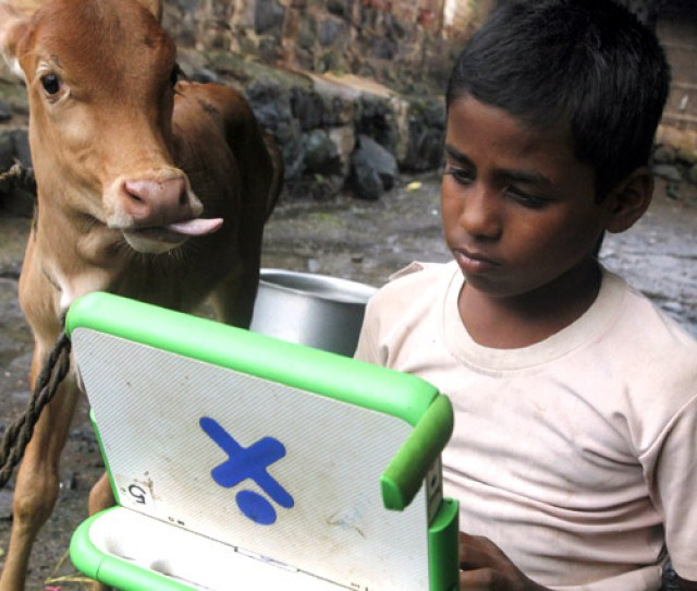 A Schoolboy Uses A Laptop Provided To Him Under One Laptop Per Child Project