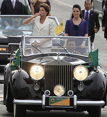 Brazil's President Dilma Rousseff and her daughter Paula ride towards Planalto Palace after she was sworn in as successor to Luiz Inacio Lula da Silva