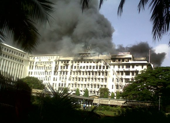 Smoke rises from the Mantralaya after a fire broke out on the fourth floor of the building on Thursday afternoon