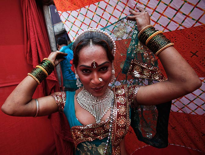 Raksha, a sex worker, prepares for a performance in Kamathipura.
