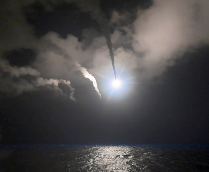 A US Tomahawk missile heads for the al-Shayrat military airfield near Homs in Syria. Photograph: US Department of Defence/Reuters