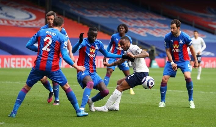 Manchester City's Raheem Sterling tries to make his way past Crystal Palace's Cheikhou Kouyate, Scott Dann, Eberechi Eze, Luka Milivojevic and Joel Ward.