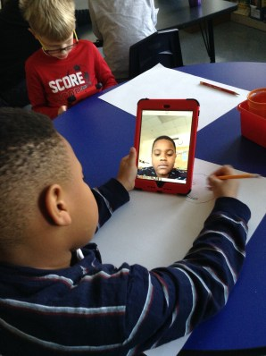 This friend used an iPad to see their face in order to draw the portrait of what they want to be when they grow up.