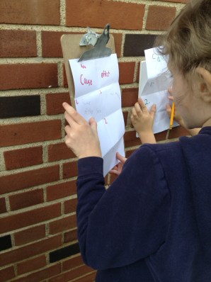 These first grade scientists are writing down observations from nature that show cause and effect.