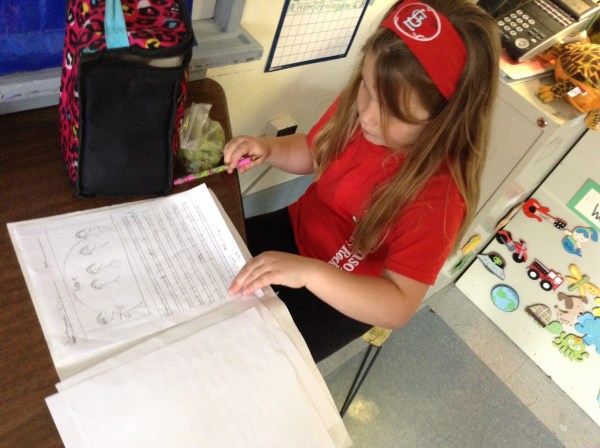 These first graders edited their friend's writing pieces.