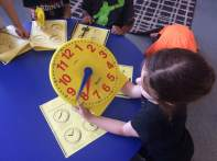 Exploring some clocks to learn how to tell time.