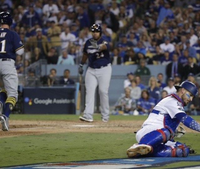 Los Angeles Dodgers Catcher Yasmani Grandal Goes After A Wild Pitch As Milwaukee Brewers Travis
