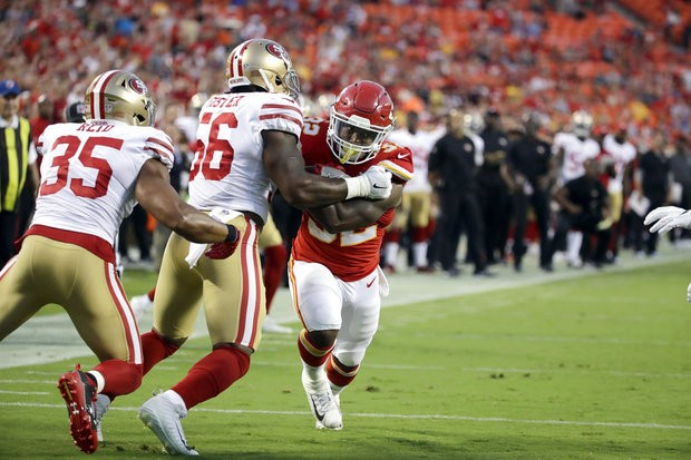 San Francisco 49ers linebacker Reuben Foster stops Kansas City Chiefs running back Spencer Ware during the first half of an NFL preseason game in Kansas City, Mo., on Friday, Aug. 11, 2017.