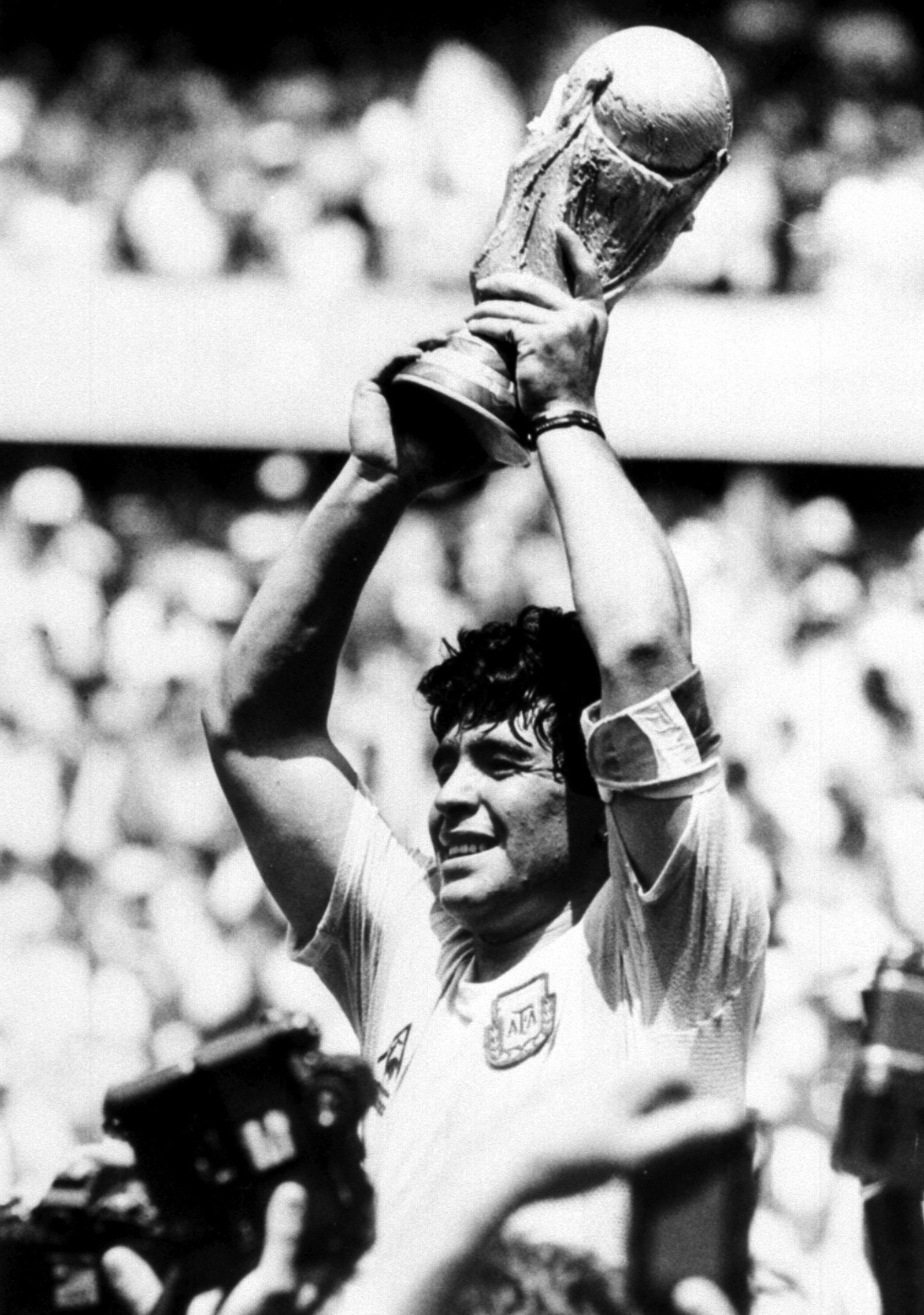 Maradona holds aloft the World Cup in 1986