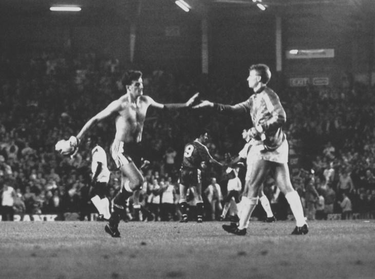 Liverpool striker John Aldridge exchanges 'take fives' with Crystal Palace goalkeeper Perry Suckling