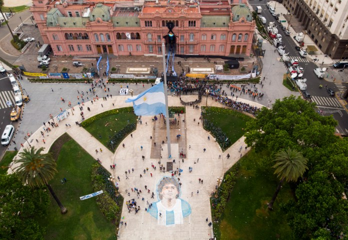 People line up to attend the wake of Diego Maradona at the presidential palace in Buenos Aires