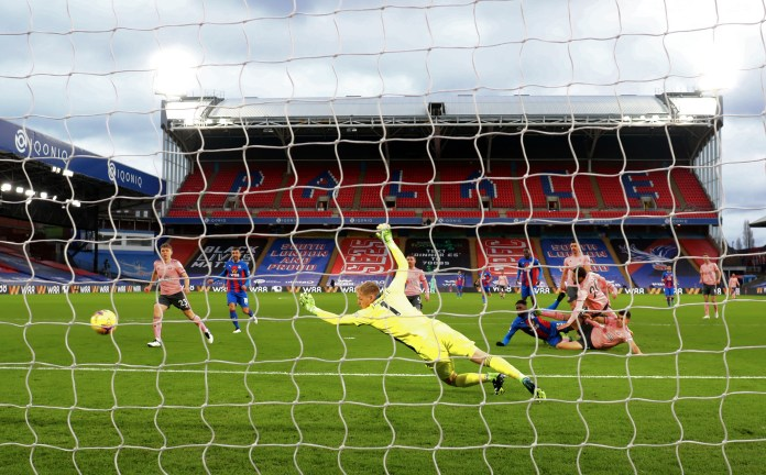 Jeffrey Schlupp, centre right, scores Crystal Palace's first goal against Sheffield United