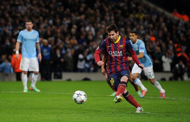 Barcelona's Lionel Messi scores from the penalty spot