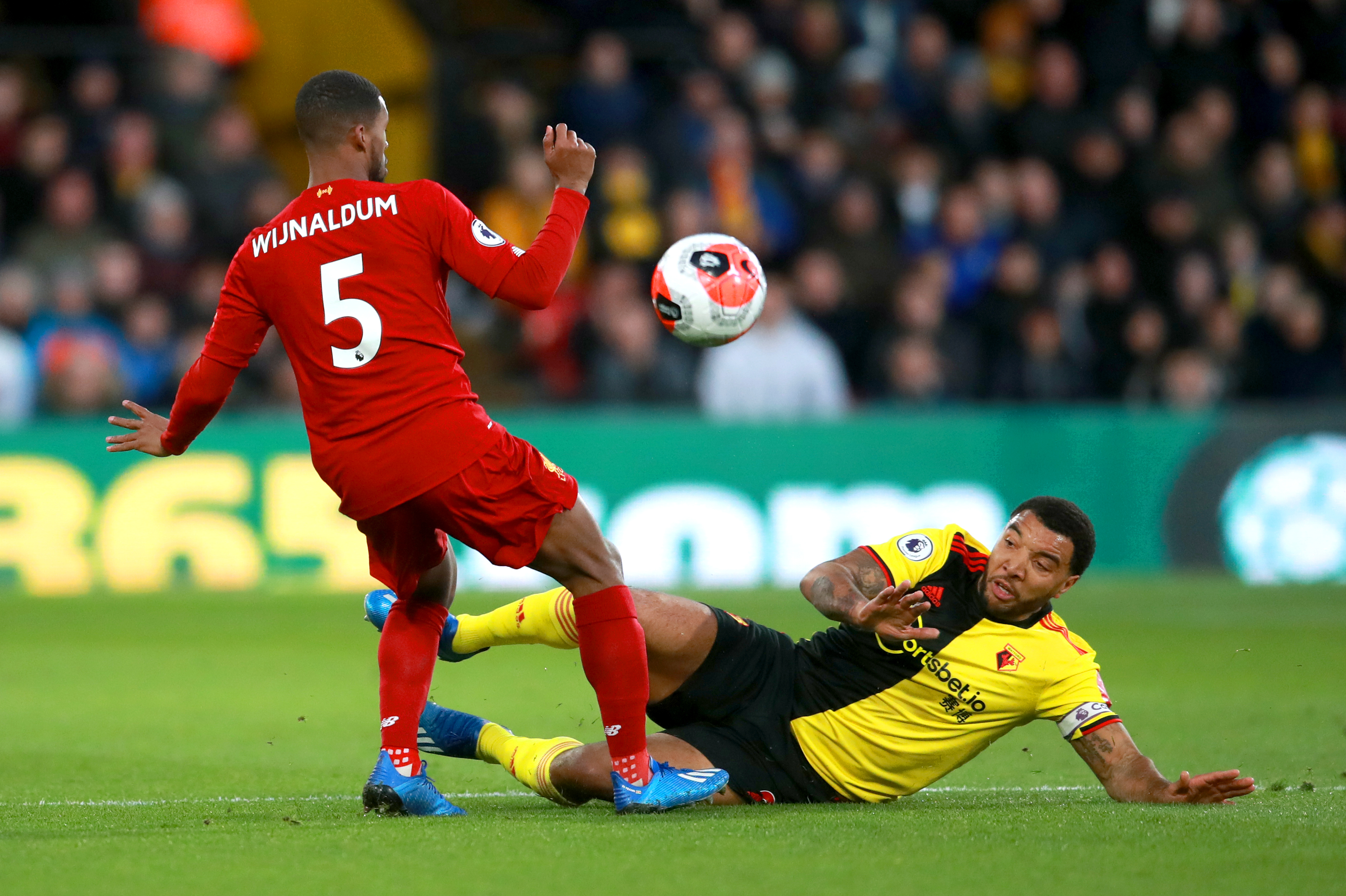 Liverpool's unbeaten Premier League run came to a shuddering halt at 44 games following a shock loss at lowly Watford. Troy Deeney, right, added to a brace from Ismaila Sarr to complete a resounding 3-0 scoreline as the Reds were stunned at Vicarage Road