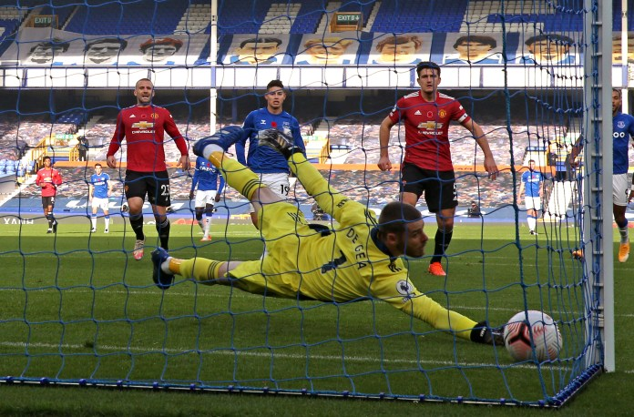 Manchester United goalkeeper David De Gea dives in vain to try and keep out Bernard's shot
