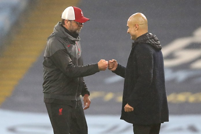 Jurgen Klopp (left) was pleased with the performance against Pep Guardiola's Manchester City