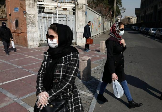Pedestrians wear masks in Tehran