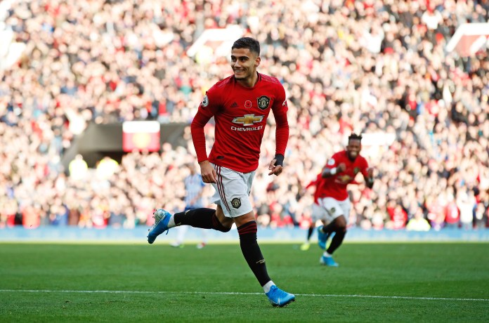 Andreas Pereira celebrates the kick-off of Manchester United