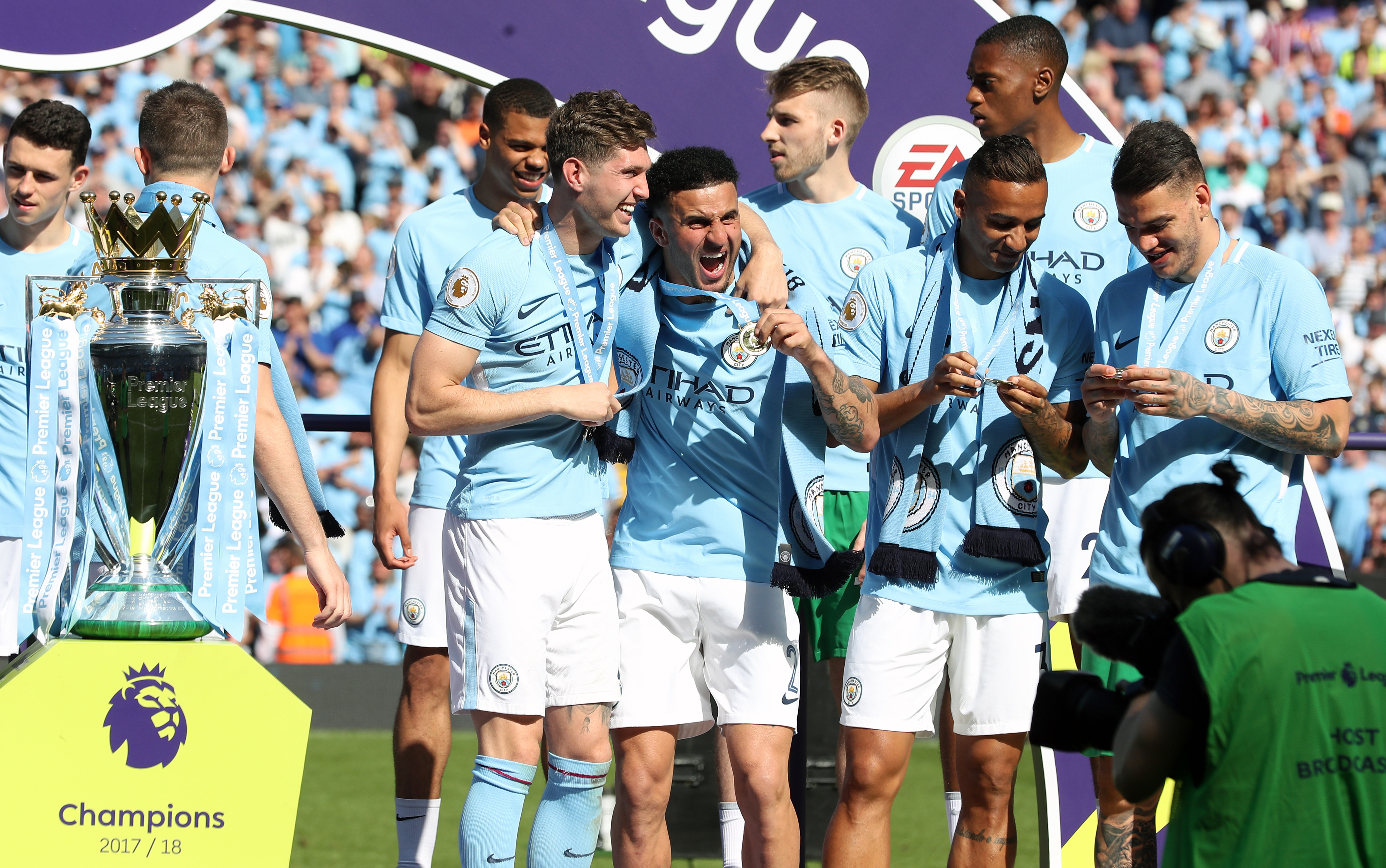 Kyle Walker, centre, won the Premier League in his first season with Manchester City