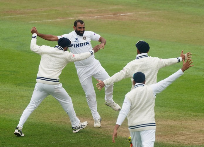 Mohammed Shami, centre left, celebrates the wicket of BJ Watling, not pictured