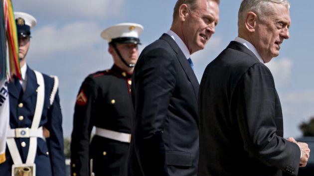 James Mattis, U.S. Secretary of Defense, right, and Patrick Shanahan, Deputy Secretary of Defense, wait outside the Pentagon before an event in Washington, D.C., on Thursday, Aug. 9, 2018.