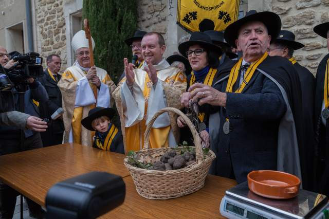 The annual truffle mass, where black truffles are donated to the local church.
