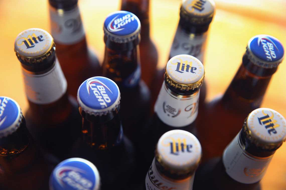 In this photo illustration, bottles of Miller Lite and Bud Light beer that are products of SABMiller and Anheuser-Busch InBev (respectively) are shown on September 15, 2014 in Chicago.