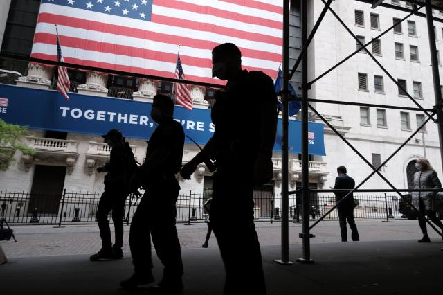 The New York Stock Exchange (NYSE) stands in lower Manhattan on the first day that traders are allowed back onto the historic floor of the exchange on May 26, 2020 in New York City.