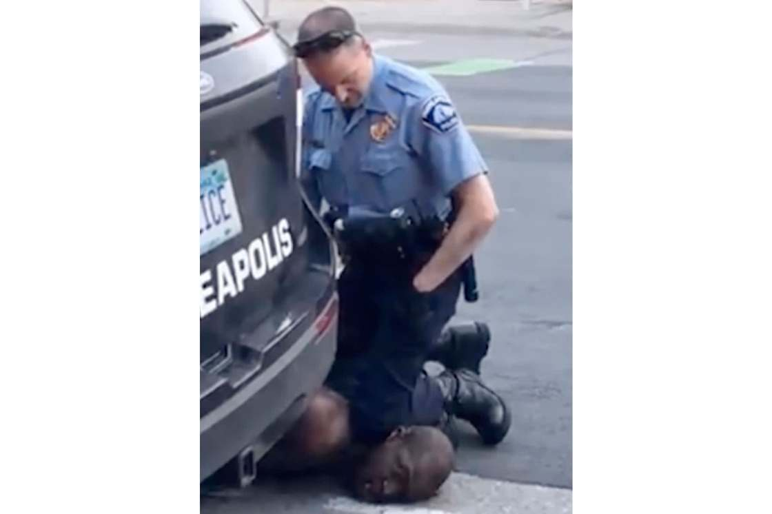 In this Monday, May 25, 2020, frame from video provided by Darnella Frazier, a Minneapolis officer kneels on the neck of a handcuffed man who was pleading that he could not breathe in Minneapolis. Four Minneapolis officers involved in the arrest of a Geor