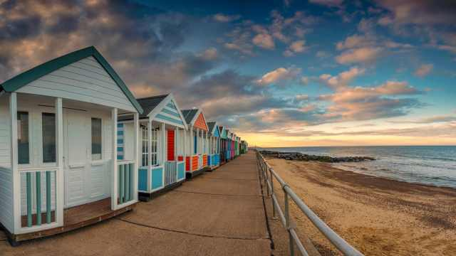 Brightly-colored beach huts in Southwold, a small seaside town in Suffolk, U.K.