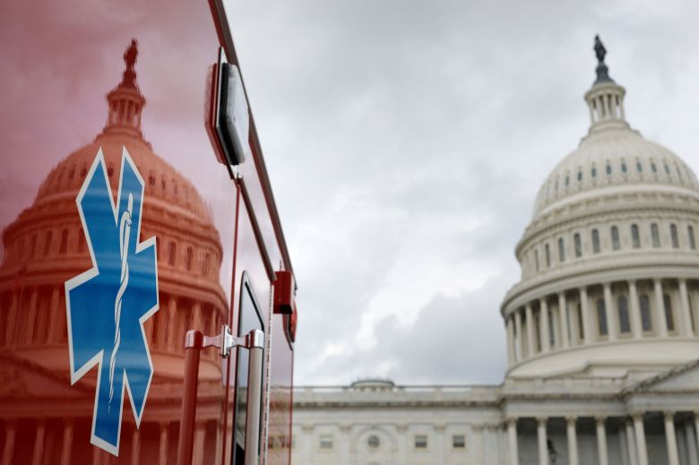The U.S. Capitol Building is reflected against an ambulance along the East Front on Capitol Hill in Washington, U.S., July 16, 2020.