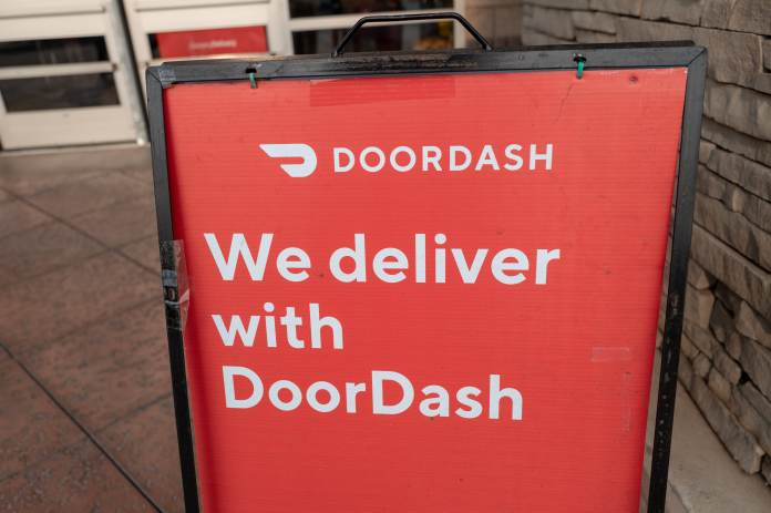 DoorDash shares rise as delivery company boosts outlook, investors shrug off driver shortage