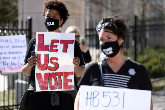 U.S. companies face boycott threats, mounting pressure to take sides in America's voting rights battle
