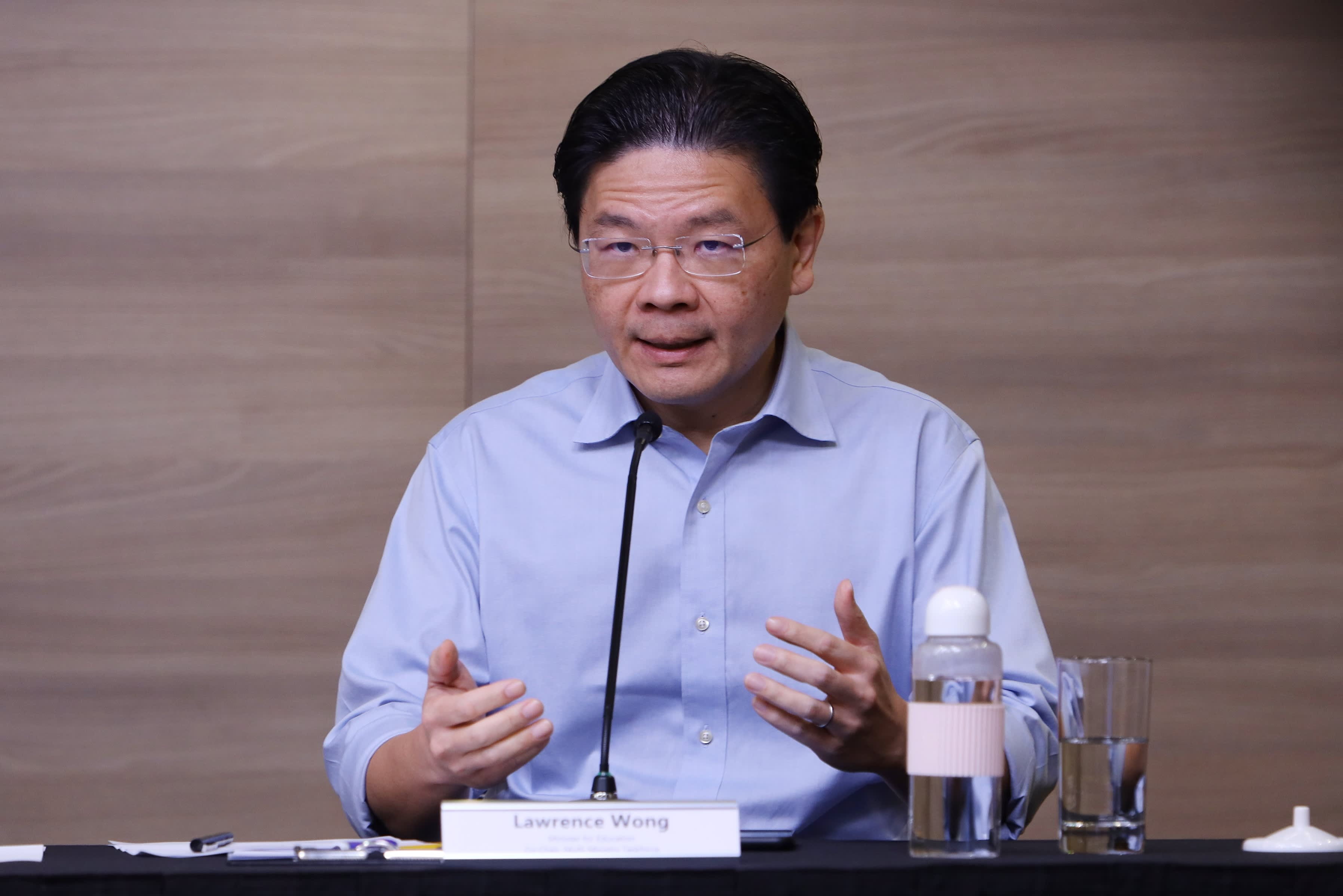 Singapore names new finance minister in cabinet reshuffle after setback in leadership succession