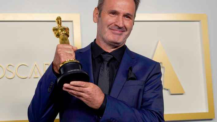 "Scott R. Fisher, winner of Best Visual Effects for ""Tenet"", poses in the press room during the Oscars on Sunday, April 25, 2021, at Union Station in Los Angeles."
