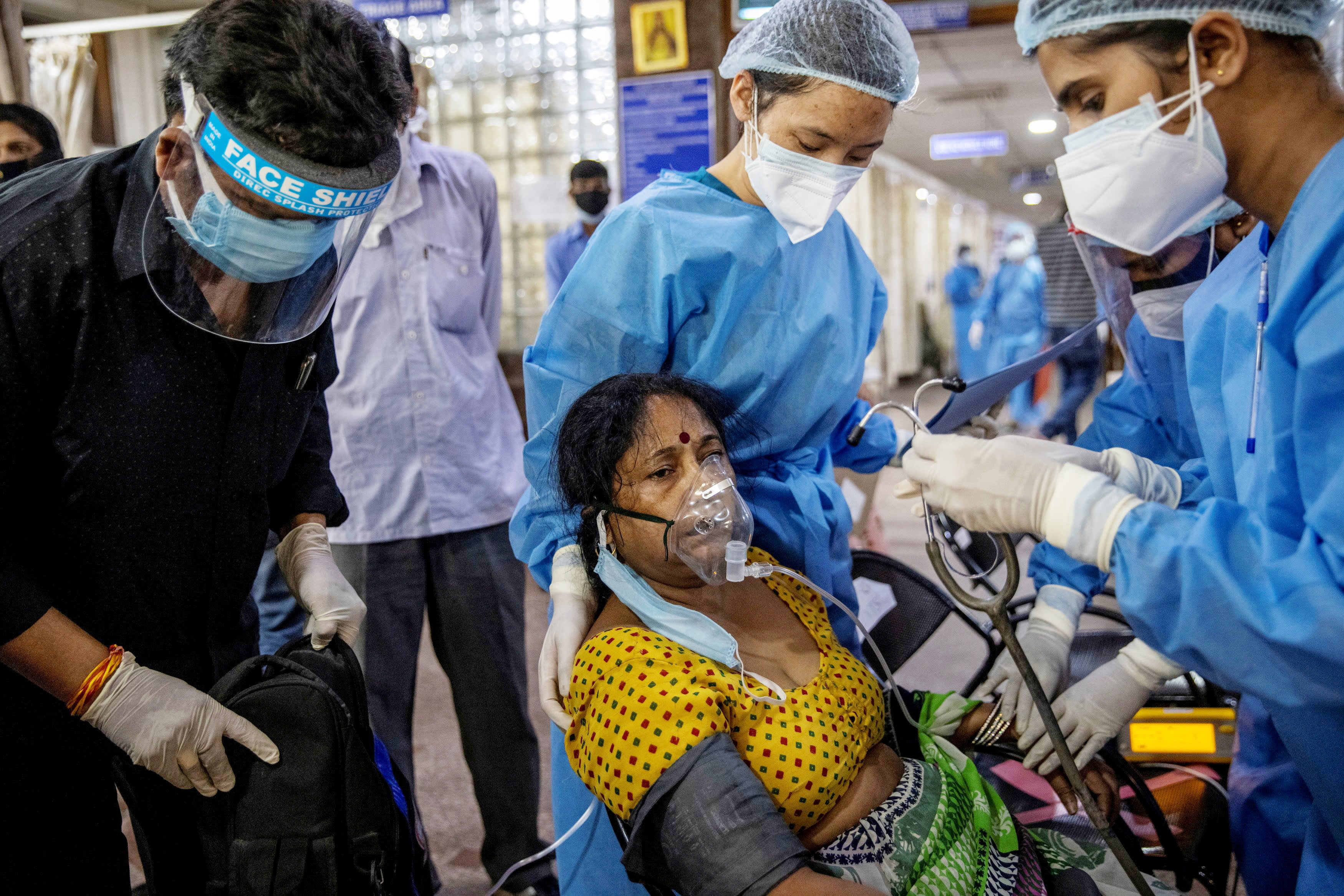 India reports record Covid cases again — with over 386,000 new infections