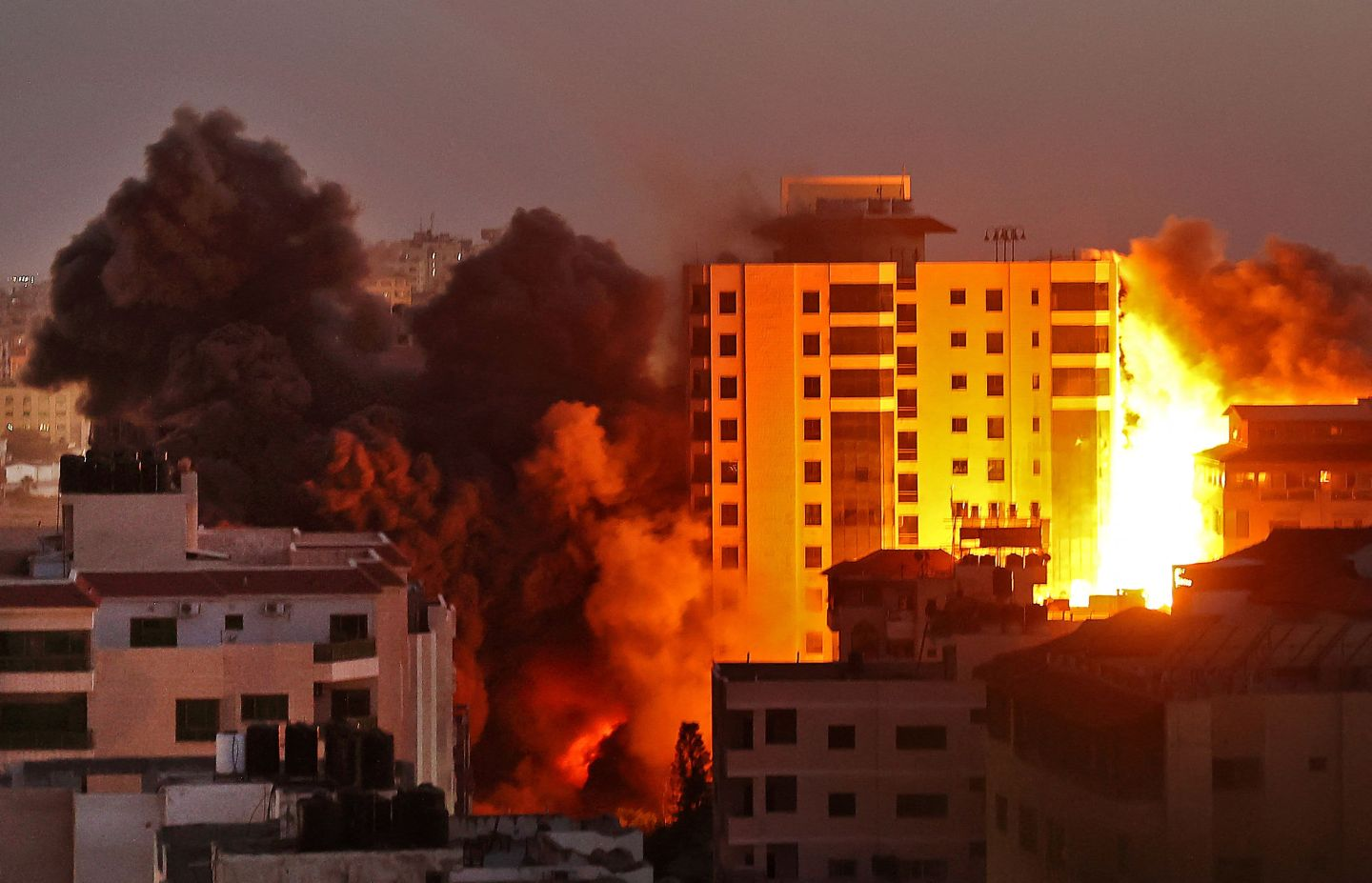 Smoke billows from an Israeli air strike on the Hanadi compound in Gaza City, controlled by the Palestinian Hamas movement, on May 11, 2021.