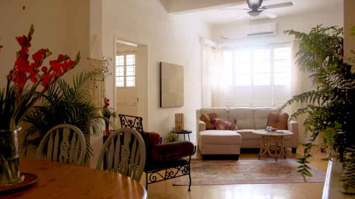 My living room is spacious and pretty, with wonderful natural light and 10-foot ceilings.
