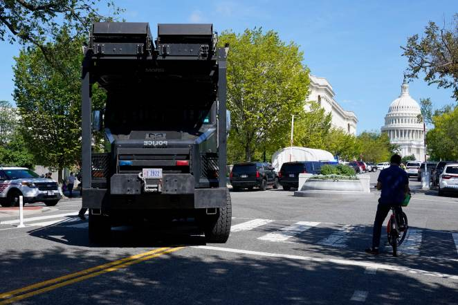 A police vehicle moves into an area near the U.S. Capitol and a Library of Congress building in Washington on Thursday, Aug. 19, 2021, as law enforcement officials investigate a report of a pickup truck containing an explosive device.