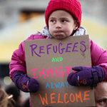 Protest sign reading refugees welcome