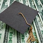 graduation cap sitting on money