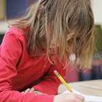 third grade student writing
