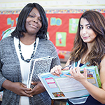 teacher and paraeducator working together