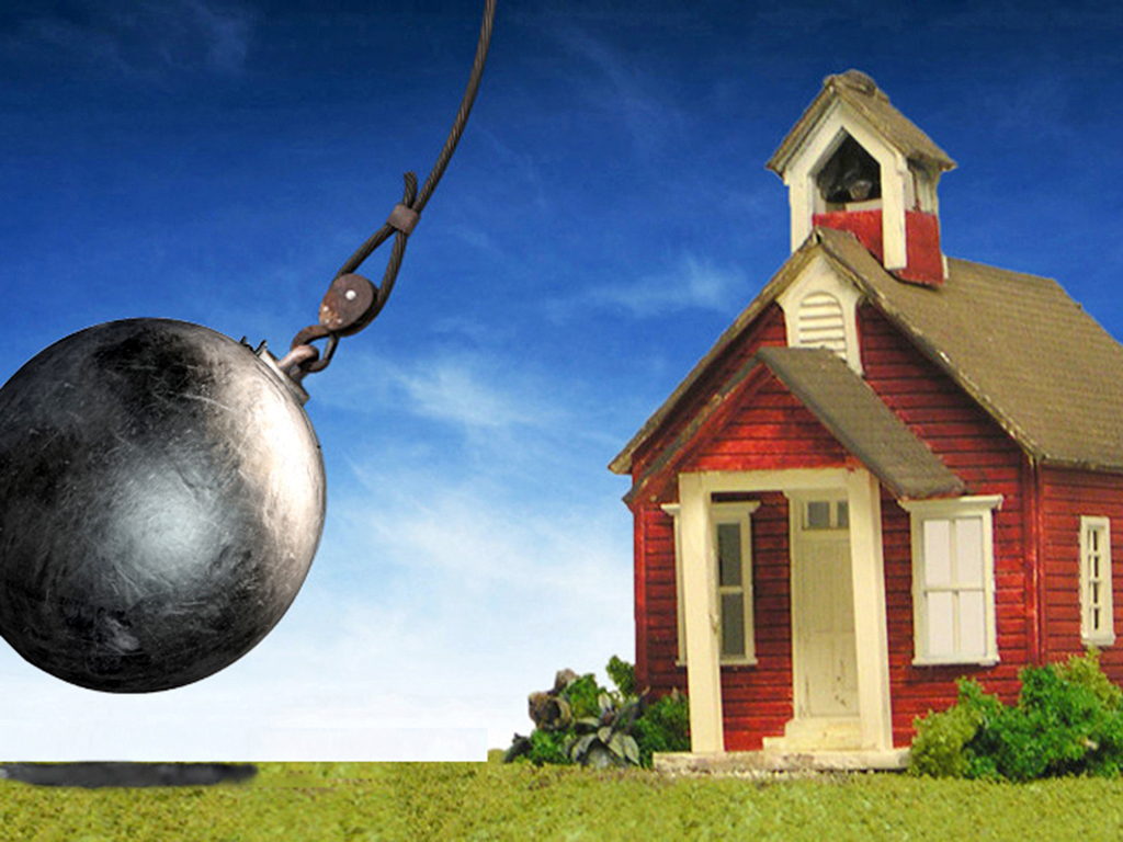 wrecking ball hitting schoolhouse